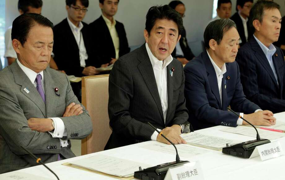 Japanese Prime Minister Shinzo Abe, second from left, speaks during a joint-meeting by Nuclear Emergency Response Headquarters and Nuclear Power Disaster Management Council at the prime minister's official residence in Tokyo Tuesday, Sept. 3, 2013. (AP Photo/Shizuo Kambayashi, Pool) ORG XMIT: XKAN101 Photo: Shizuo Kambayashi / AP POOL