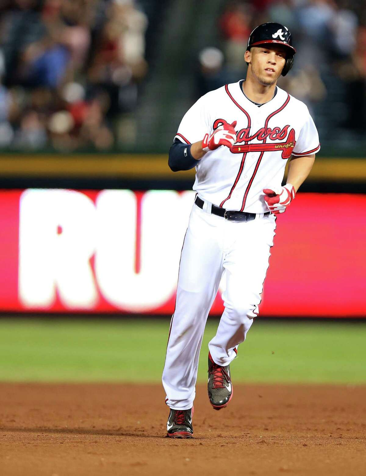 ATLANTA, GA - SEPTEMBER 03: Shortstop Andrelton Simmons #19 of the Atlanta Braves rounds the bases after hitting a 2-run go-ahead home run in the seventh inning during the game against the New York Mets at Turner Field on September 3, 2013 in Atlanta, Georgia. (Photo by Mike Zarrilli/Getty Images) ORG XMIT: 163495343