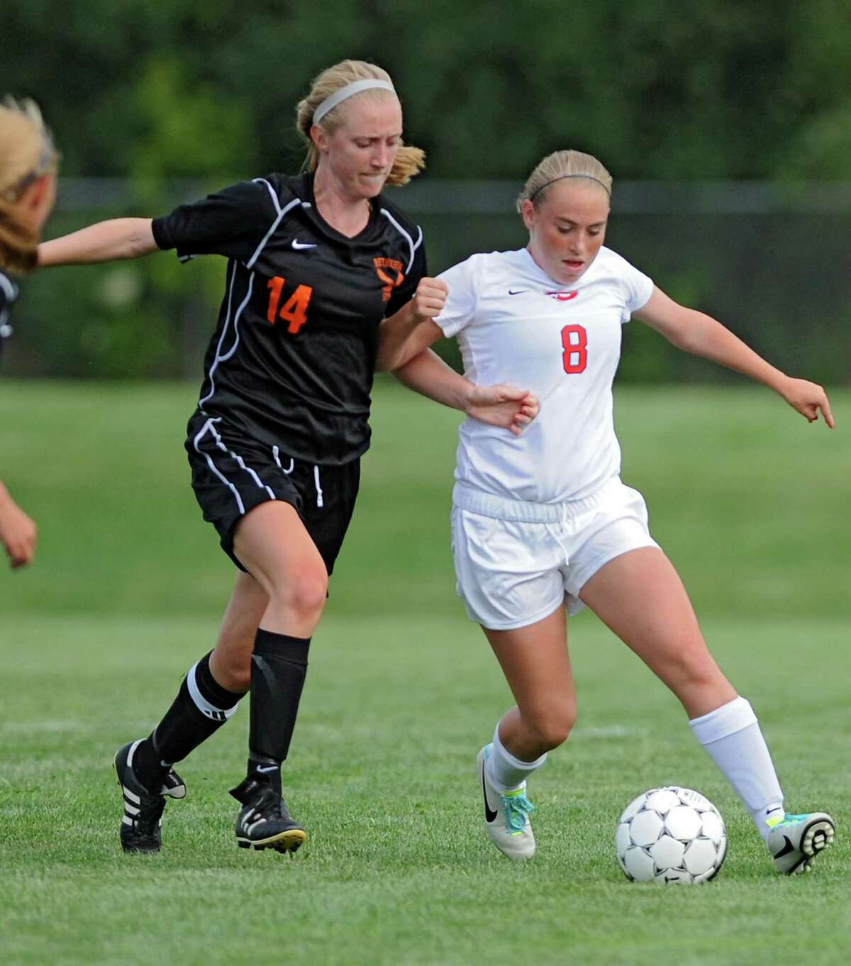 Bethlehem's Samantha Taillon battles for the ball with Guilderland's Breanne Ford during a soccer game on Tuesday, Sept. 3, 2013 in Guilderland, N.Y. (Lori Van Buren / Times Union)
