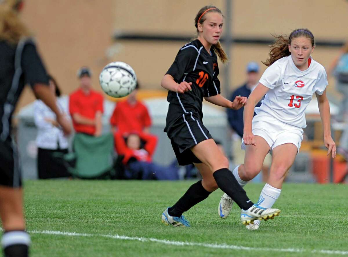 Bethlehem's Ellie Warner-Rousseau watches the ball get kicked pass by her by Guilderland's Emma Oliver during a soccer game on Tuesday, Sept. 3, 2013 in Guilderland, N.Y. (Lori Van Buren / Times Union)