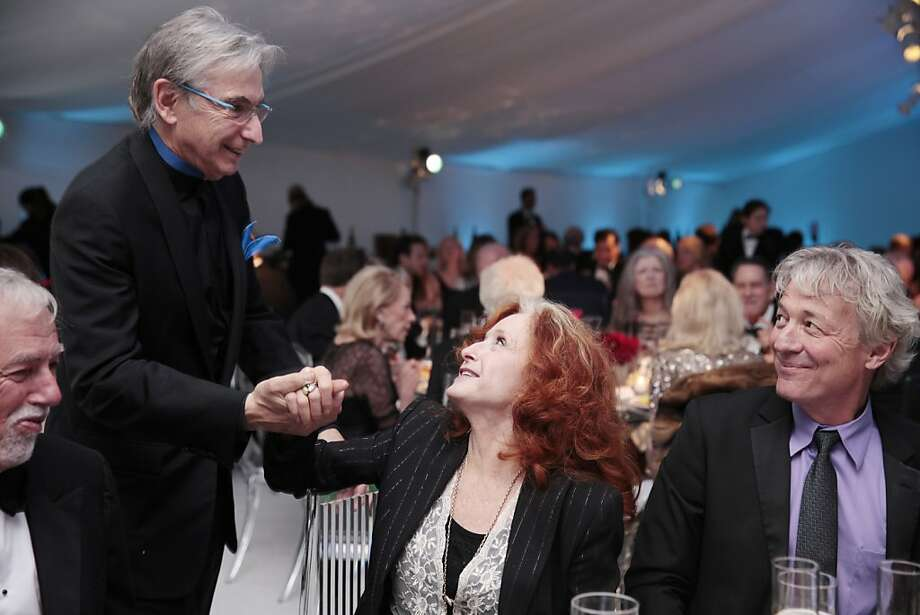 Michael Tilson Thomas, the music director of the San Francisco Symphony, greets Bonnie Raitt, blues singer-songwriter, at the 102nd San Francisco Symphony Gala in San Francisco Calif. on Tuesday, Sept. 3, 2013. Photo: Alex Washburn, Special To The Chronicle