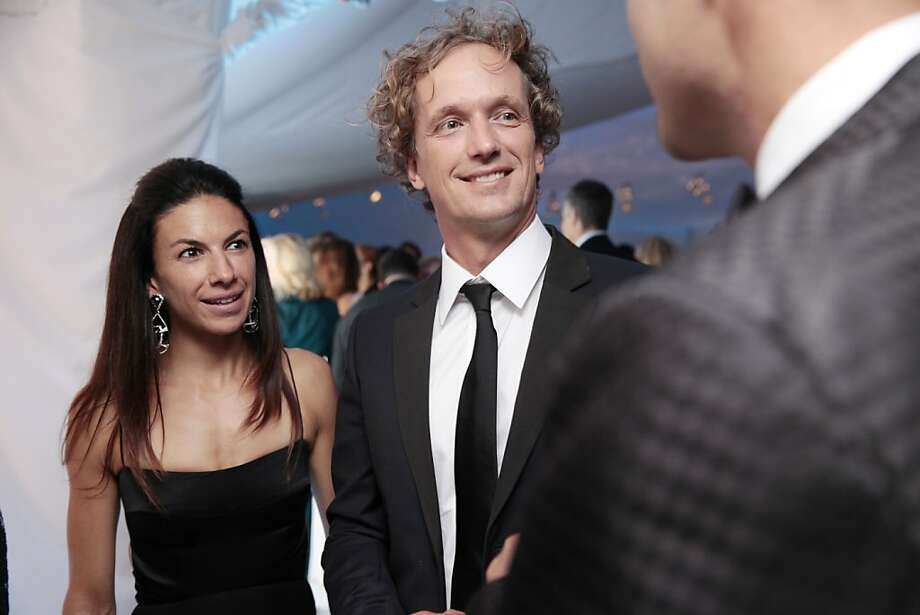 Designer Yves Behar (center) and his partner Sabrina Buell (left) arrive to the dinner portion of the 102nd San Francisco Symphony Gala in San Francisco Calif. on Tuesday, Sept. 3, 2013. Photo: Alex Washburn