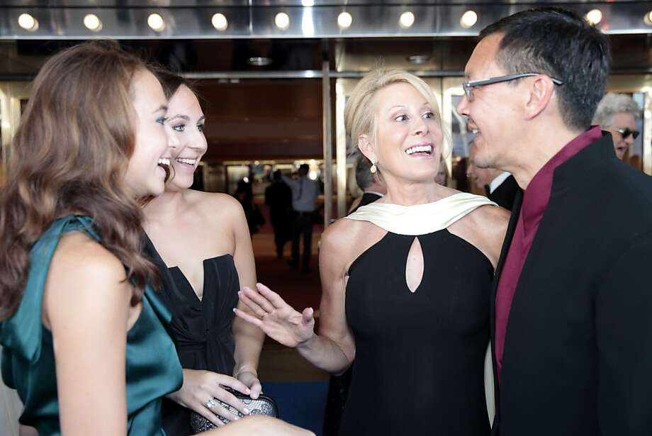 Rose Fisher (left) and Remy Fisher (second from left) socialize with Jillian Manus and Tim Wu before the 102nd San Francisco Symphony Gala in San Francisco Calif. on Tuesday, Sept. 3, 2013. Photo: Alex Washburn, Special To The Chronicle