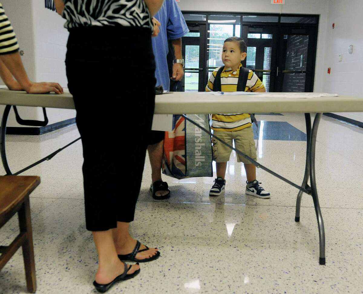 Pre-k student, Nicholas DeSanto, 4, waits for his father, Ralph DeSanto to sign in as they arrived for the first day of school Tuesday morning, Sept. 3, 2013, at Van Rensselaer Elementary School in Rensselaer, NY. (Paul Buckowski / Times Union)