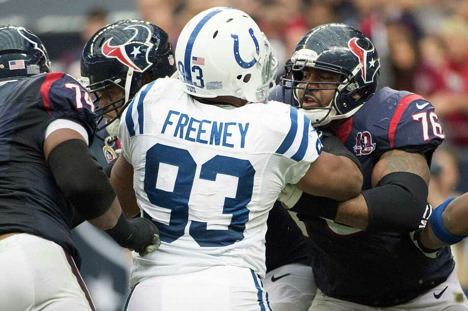 Texans tackle Duane Brown, right, thought his days of butting heads with Dwight Freeney would occur infrequently with Freeney leaving the Colts, but they'll get reacquainted in the season opener at San Diego. Photo: Smiley N. Pool, Staff / © 2012  Houston Chronicle
