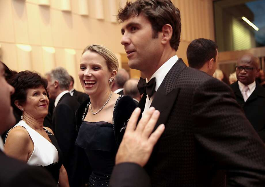 Yahoo CEO Marissa Mayer (left) and her husband Zachary Bogue (right) attend the 102nd San Francisco Symphony Gala in San Francisco Calif. on Tuesday, Sept. 3, 2013. Photo: Alex Washburn, Special To The Chronicle