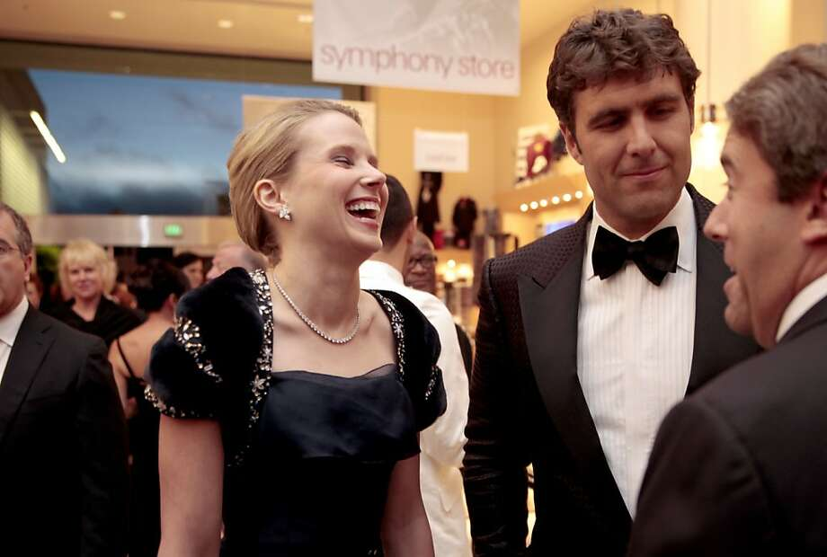 Yahoo CEO Marissa Mayer (left) and her husband Zachary Bogue (right) attend the 102nd San Francisco Symphony Gala in San Francisco Calif. on Tuesday, Sept. 3, 2013. Photo: Alex Washburn