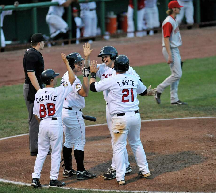 Tri-City ValleyCats' Conrad Gregor and Tyler White celebrate  with teammates after scoring runs with against the Brooklyn Cyclones during a minor league baseball game in Troy, N.Y., Tuesday, Sept. 3, 2013. (Hans Pennink / Special to the Times Union) ORG XMIT: HP114 Photo: Hans Pennink / Hans Pennink
