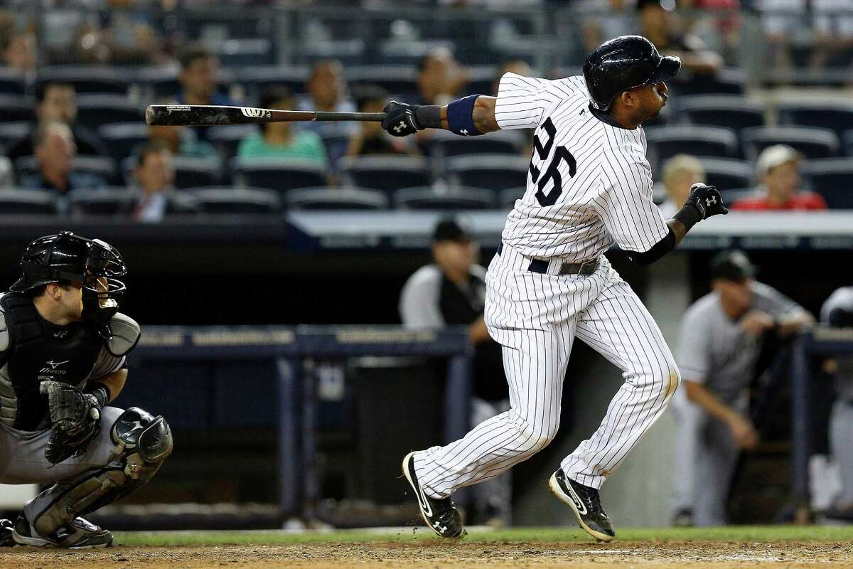 New York Yankees' Eduardo Nunez (26) hits a two-run double in the eighth inning of a baseball game against Chicago White Sox at Yankee Stadium, Tuesday, Sept. 3, 2013, in New York. The Yankees won 6-4. (AP Photo/John Minchillo) ORG XMIT: NYJM119