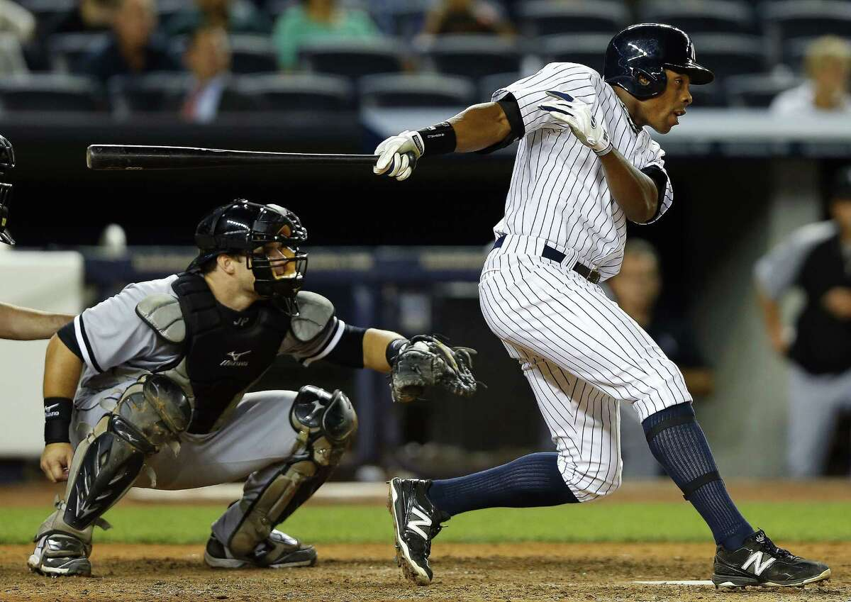 NEW YORK, NY - SEPTEMBER 3: Curtis Granderson #14 of the New York Yankees singles in two runs to tie the game during the eighth inning against the Chicago White Sox at Yankee Stadium on September 3, 2013 in the Bronx borough of New York City. The Yankees defeated the White Sox 6-4. (Photo by Rich Schultz/Getty Images) ORG XMIT: 163495334