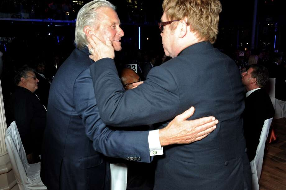 Michael Douglas (L) and Sir Elton John attend the GQ Men of the Year awards at The Royal Opera House on September 3, 2013 in London, England.  (Photo by David M. Benett/Getty Images) Photo: David M. Benett, Getty Images