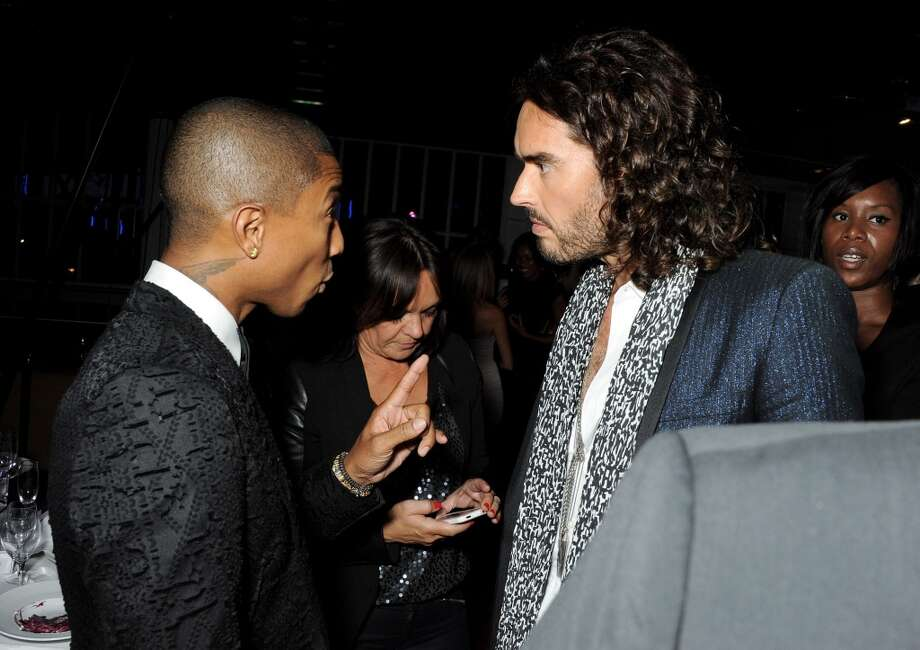 Pharrell Williams (L) and Russell Brand attend an after party following the GQ Men of the Year awards at The Royal Opera House on September 3, 2013 in London, England.  (Photo by David M. Benett/Getty Images) Photo: David M. Benett, Getty Images