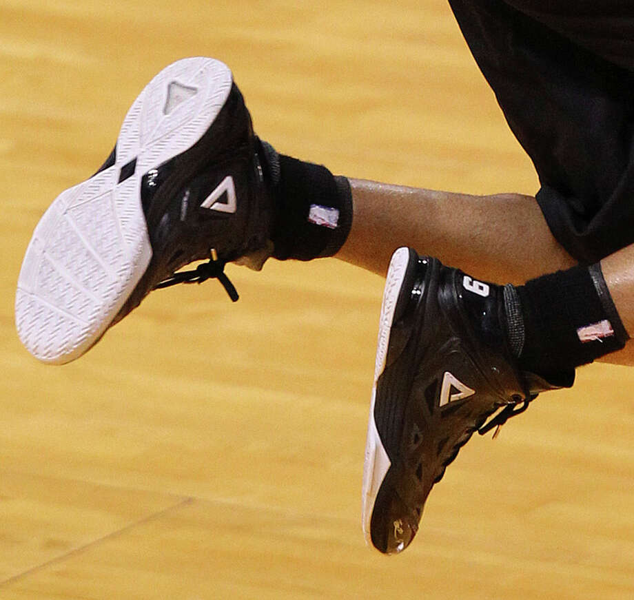 One of the Big Three has the team's daintiest feet. These size 11.5s belong to ... Photo: Jerry Lara, San Antonio Express-News / ©2013 San Antonio Express-News