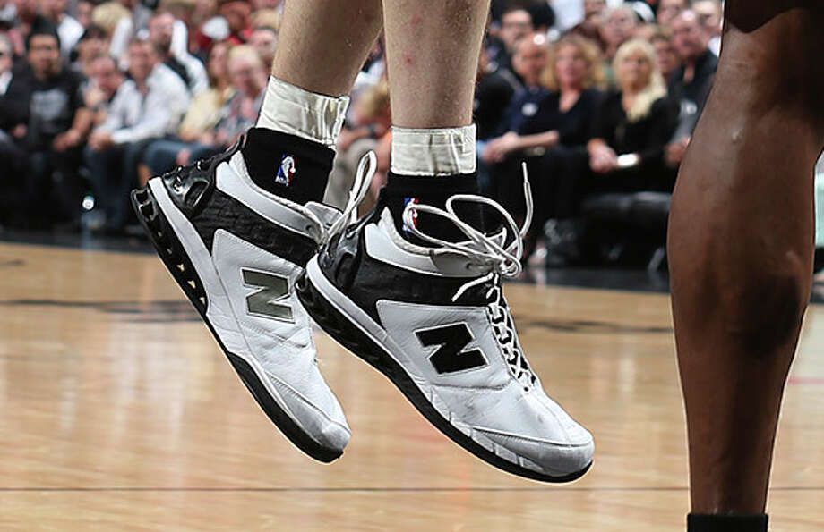 However, at size 17, the biggest shoes on the Spurs belong to ... Photo: Jerry Lara, San Antonio Express-News / ©2013 San Antonio Express-News