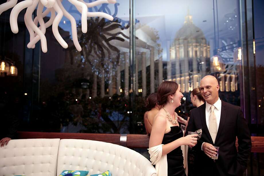 Amy Sedan and Paul Zach share a drink before the performance during the 102nd San Francisco Symphony Gala at Davies Symphony Hall in San Francisco Calif. on Tuesday, Sept. 3, 2013. Photo: Alex Washburn