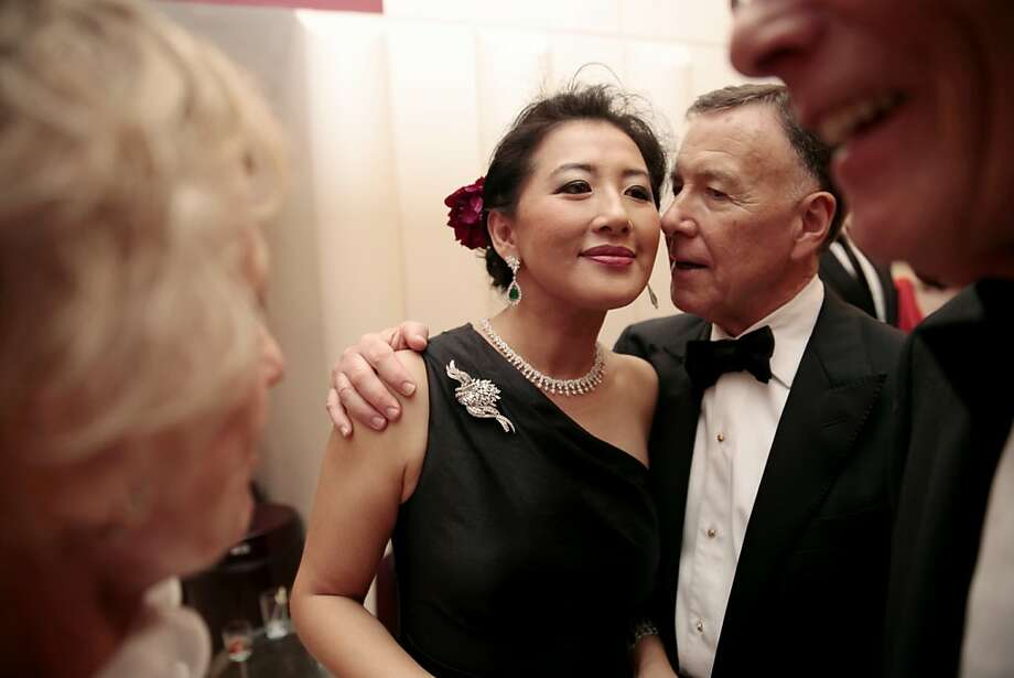 Carl Pascarella (right) whispers something to Gala Chairwoman Gorretti Lui (left) as they make their way in to enjoy the performance at the 102nd San Francisco Symphony Gala in San Francisco Calif. on Tuesday, Sept. 3, 2013. Photo: Alex Washburn, Special To The Chronicle