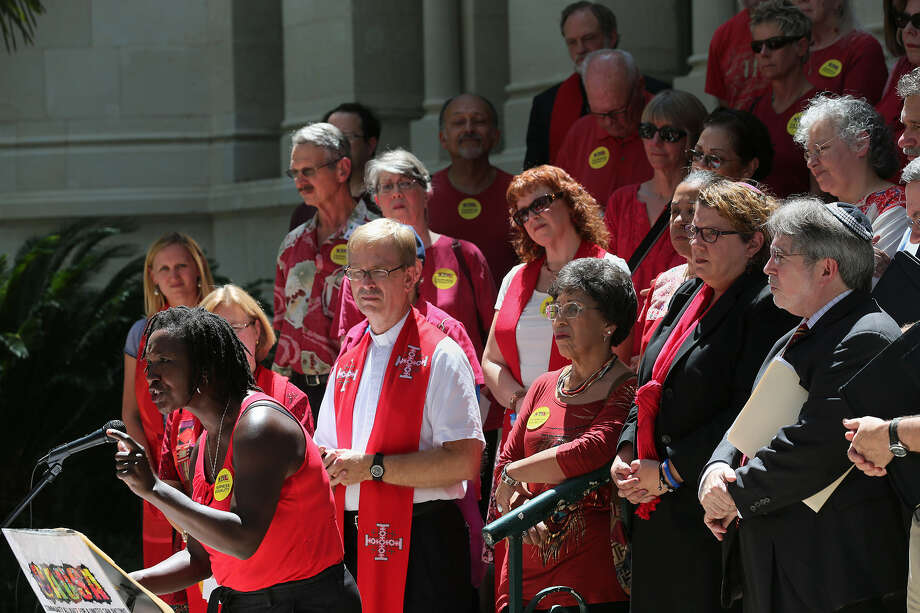 The Rev. Erika Forbes of Awakening Spiritual Community joins other clergy at City Hall in support of the ordinance. Photo: Jerry Lara / San Antonio Express-News