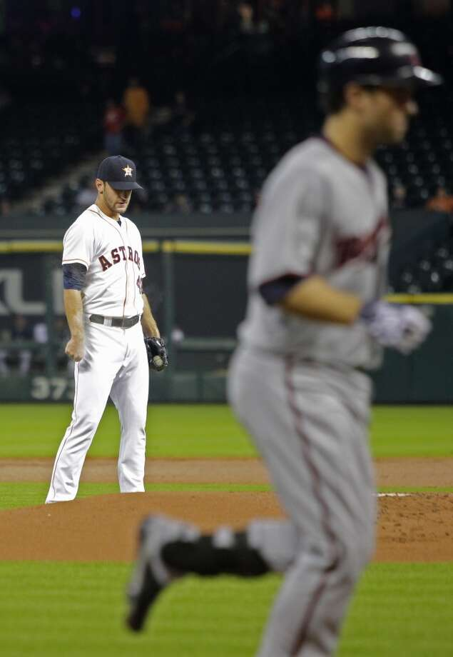 Astros pitcher Jarred Cosart looks on after Brina Dozier of the Twins hit a home run off him. Photo: Melissa Phillip, Houston Chronicle