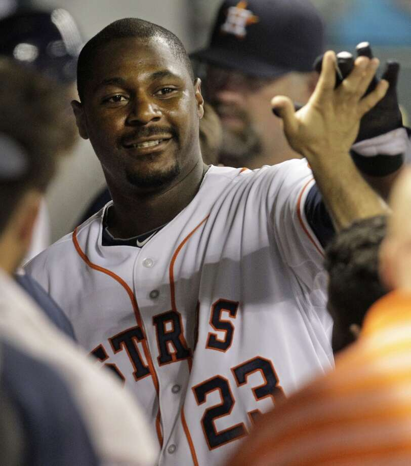 Chris Carter of the Astros in congratulated by teammates after hitting a solo home run against the Twins. Photo: Melissa Phillip, Houston Chronicle
