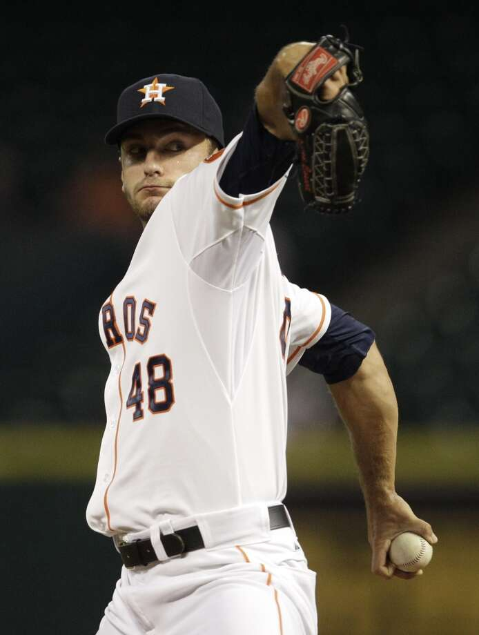 Astros pitcher Jarred Cosart delivers a throw to the Twins. Photo: Melissa Phillip, Houston Chronicle