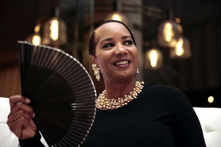 Karen Cundiff fans herself during the intermission of the performance at the 102nd San Francisco Symphony Gala in San Francisco Calif. on Tuesday, Sept. 3, 2013.  Michael Tilson Thomas led the orchestra in Gershwin's An American in Paris and Antheil's Jazz Symphony. Audra McDonald joined the orchestra to perform selections from the American Songbook. Photo: Alex Washburn, Special To The Chronicle
