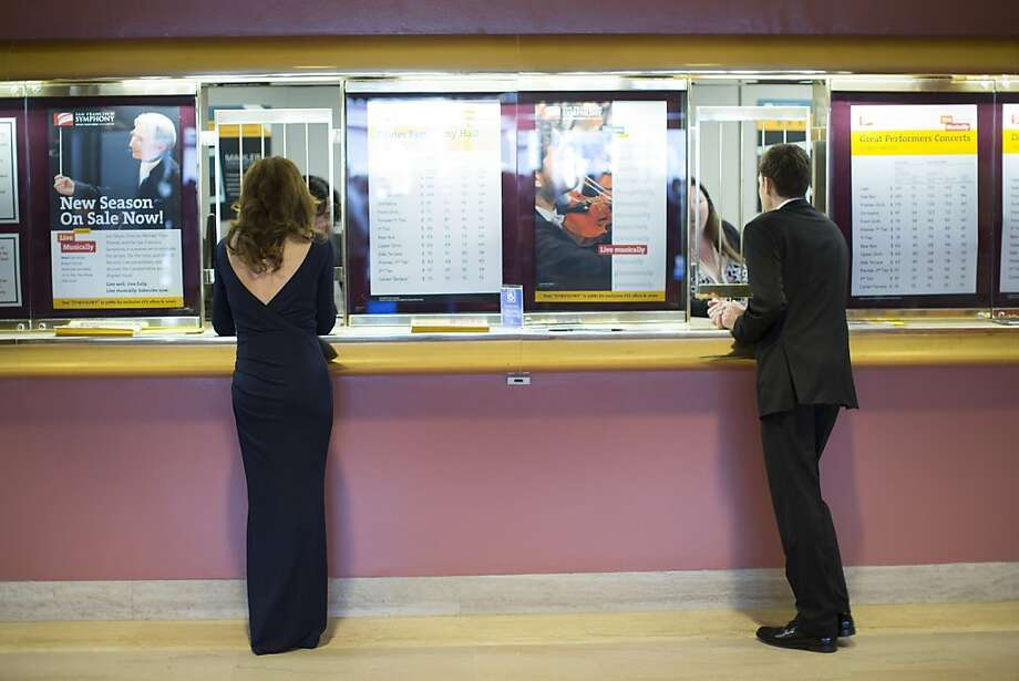 Sophie Ross, left, and Oliver Theil stand in front of the ticket booth during the 102nd Symphony gala opening night at Davies Symphony Hall in San Francisco, Calif. on Tuesday, Sept. 3, 2013. Photo: Stephen Lam, Special To The Chronicle