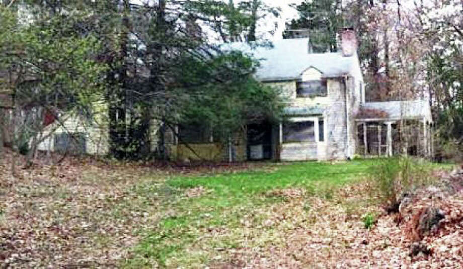 This home was recently torn down on Partrick Road, after languishing in disrepair for 19 years. Photo: Cameron Martin / Westport News