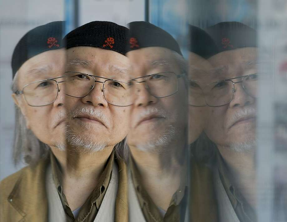Manga artist Leiji Matsumoto is reflected on glass panels as he poses for portraits at the 70th edition of the Venice Film Festival held from Aug. 28 through Sept. 7, in Venice, Italy, Tuesday, Sept. 3, 2013. (AP Photo/Domenico Stinellis) Photo: Domenico Stinellis, Associated Press