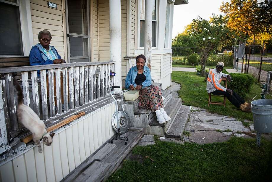 DETROIT, MI - SEPTEMBER 03:  John Fullmore (R), sits on his porch with his wife Magnolia Fullmore (L) and their neighbor Pinkie Dawkin (C) on September 3, 2013 in Detroit, Michigan. Fullmore, who is originally from Georgia, moved to Detroit in 1958, where he met his wife. He worked as a metal finisher, she worked on the production line at Chrysler motors. They bought their home in 1965.  (Photo by Andrew Burton/Getty Images) Photo: Andrew Burton, Getty Images