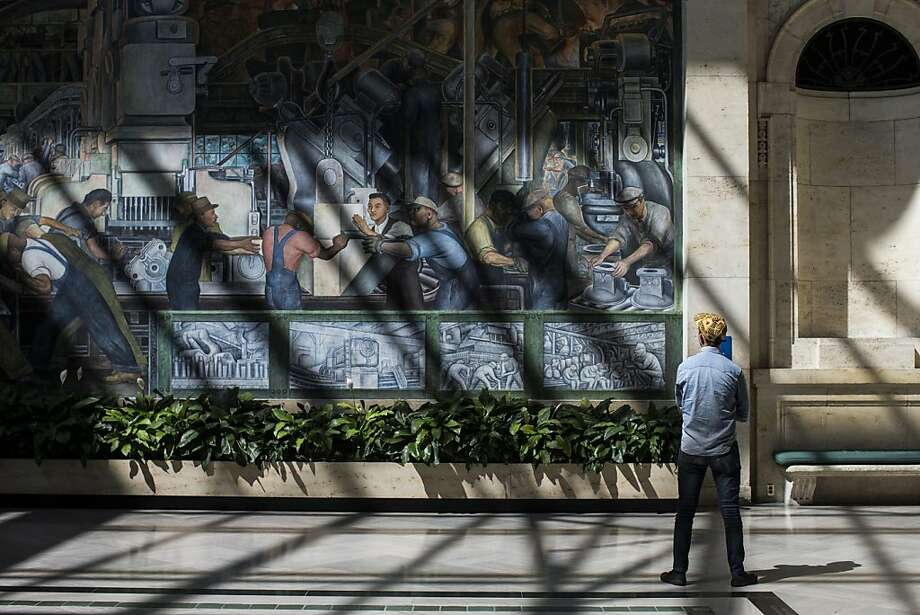 DETROIT, MI - SEPTEMBER 03:  A man looks at a Diego Rivera mural at the Detroit Institute of Arts (DIA) on September 3, 2013 in Detroit, Michigan. Detroit, once known as powerhouse for creativity, engineering and manufacturing thanks to the many automotive companies based here, had to declare bankruptcy last month after decades of a shrinking population and lack of jobs. As the city government struggles for a way to pay off its debts, the idea of selling off some of the DIA's collection has been suggested. The DIA was founded in 1885, covered over 600,000 square feet and is home to thousands of pieces of art spanning continents and millenia.   (Photo by Andrew Burton/Getty Images) Photo: Andrew Burton, Getty Images