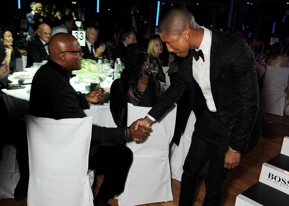 Samuel L. Jackson (L) and Pharrell Williams, winner of Best Performer, attend the GQ Men of the Year awards at The Royal Opera House on September 3, 2013 in London, England.  (Photo by David M. Benett/Getty Images) Photo: David M. Benett, Getty Images