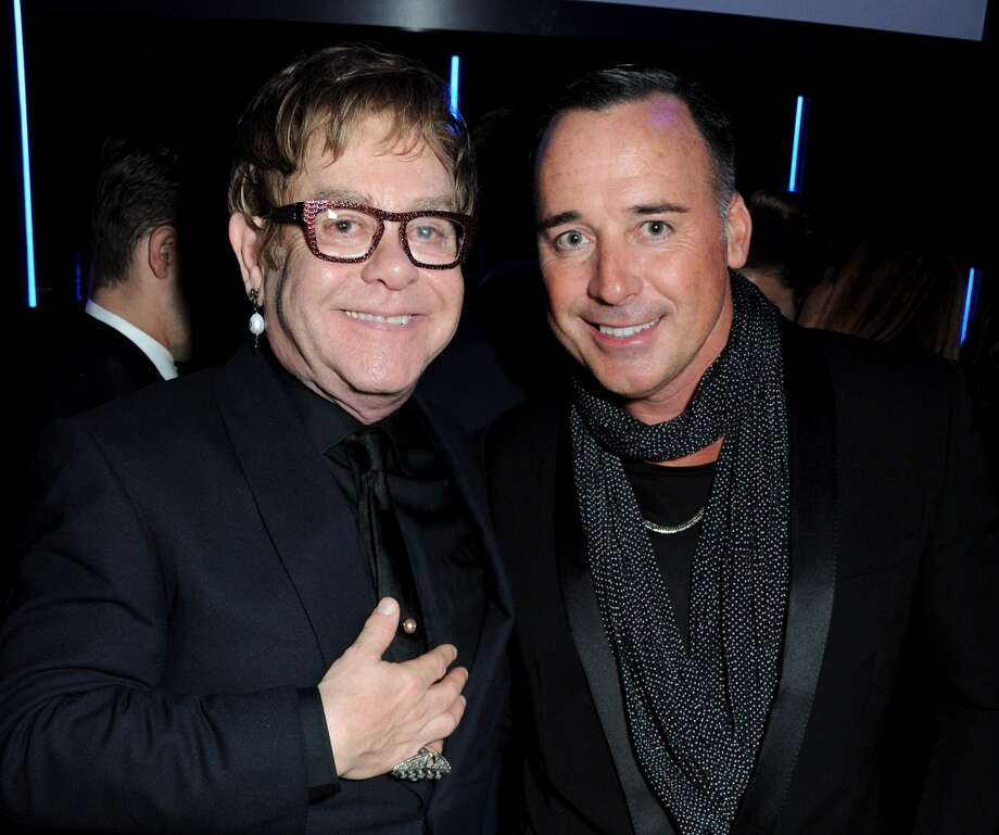 Sir Elton John (L) and David Furnish attend an after party following the GQ Men of the Year awards at The Royal Opera House on September 3, 2013 in London, England.>>  (Photo by David M. Benett/Getty Images) Photo: David M. Benett, Getty Images