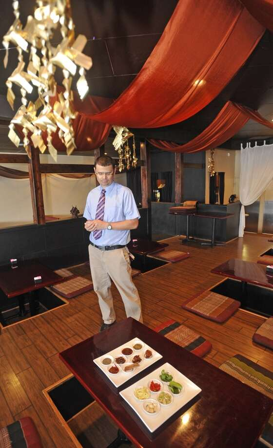 Joe Jones, co-owner of the Chaba Thai Bistro in Beaumont, talks about the many spices, seen here May 16, 2012, that his restaurant uses in their dishes. There is a strange compulsion to consume foods that can set a 3-alarm fire in the digestive system causing tears, pounding hearts and red faces.  Back in the 80s, a psychology professor brought out a study that indicated people who like spicy foods are more likely to also enjoy roller coasters. The idea is that the fire, tears, pounding heart, etc.,  give a feeling of excitement that certain personalities enjoy.  Interest in spicy foods appears to be on the rise, with hot sauce on a list of the top ten growing businesses.  Dave Ryan/The Enterprise Photo: Dave Ryan, Dave Ryan/The Enterprise