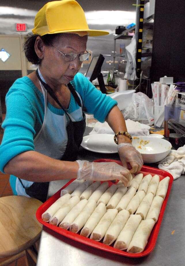 Sear prepares fresh spring rolls in the kitchen at Chaba Thai Bistro on Phelan at Dowlen.  Scott Eslinger/cat5 Photo: Scott Eslinger, Scott Eslinger/cat5