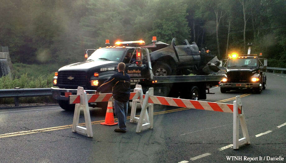 A mangled truck is removed from the scene of a fatal crash on Route 313 in Seymour, Sept. 4, 2013. Photo: WTNH Report It / Danielle