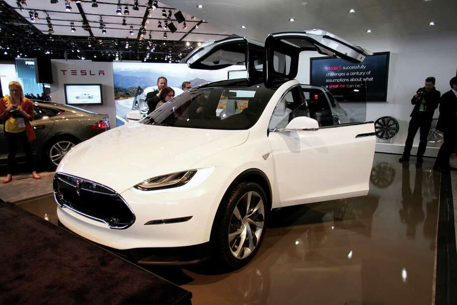Electric car maker Tesla currently makes just one sedan, the Model S. Its next vehicle, the Model X crossover, is expected to go on sale toward the end of 2014. A preproduction version shown at the Detroit auto show last January had seven seats and unique gull-wing doors that open vertically instead of sliding to the side. More details, including price and equivalent fuel economy, will be released next year. Photo: Spencer Platt, Getty Images / 2013 Getty Images