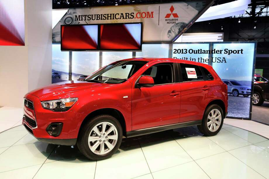 SUV is redesigned for the 2014 model year with a standard third-row seat that folds flat. Lightweight, more aerodynamic body with a 2.4-liter four-cylinder engine and continuously variable transmission. Starts at $23,820 including shipping. Photo: Raymond Boyd, Getty Images / 2013 Raymond Boyd