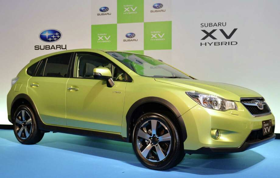 It's Subaru's first gas-electric hybrid, aimed at the environmentally sensitive outdoorsy crowd that wants efficiency while hauling kayaks to the river.  Automatic gets 33 mpg on the highway and 28 in the city. Starts at just under $22,000 excluding shipping. Photo: KAZUHIRO NOGI, AFP/Getty Images / 2013 AFP