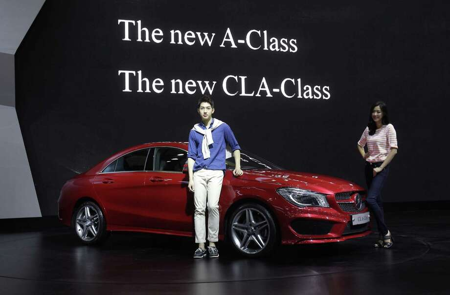 Mercedes offers a relatively low-priced entry-level small four-door car with the CLA. It looks like a coupe and has a new inline four-cylinder turbocharged engine with gasoline injected directly into cylinders. CLA250 front-drive car goes on sale in September with a 208 horsepower engine and a base price under $31,000. Photo: Chung Sung-Jun, Getty Images / 2013 Getty Images