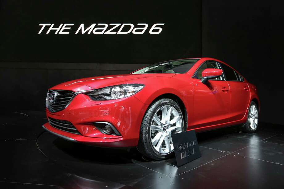 The 2014 Mazda6 midsize sedan went on sale early in 2013 but has already gotten an update. Mazda says the iELOOP system makes the Mazda6 the most fuel-efficient non-hybrid on the market, at 40 mpg on the highway and 32 in combined city/highway driving. The iELOOP system is part of a $2,000 option package on the Grand Touring edition of the Mazda6, which starts at $29,695. Photo: David Cooper, David Cooper/Getty Images / 2013 Toronto Star