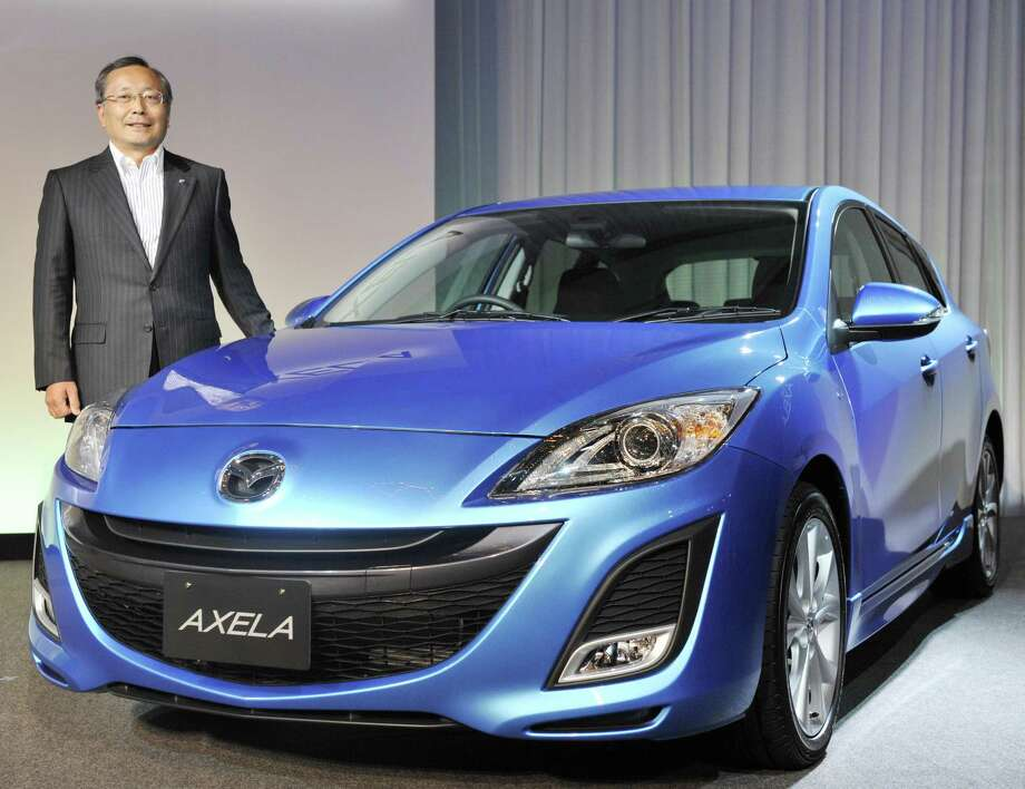 The third generation Mazda3 small car, which goes on sale this fall, now has the same elegant swooping lines, elongated hood and narrow headlights of the larger Mazda6. The Mazda3 starts at $16,945. Photo: YOSHIKAZU TSUNO, AFP/Getty Images / 2009 AFP