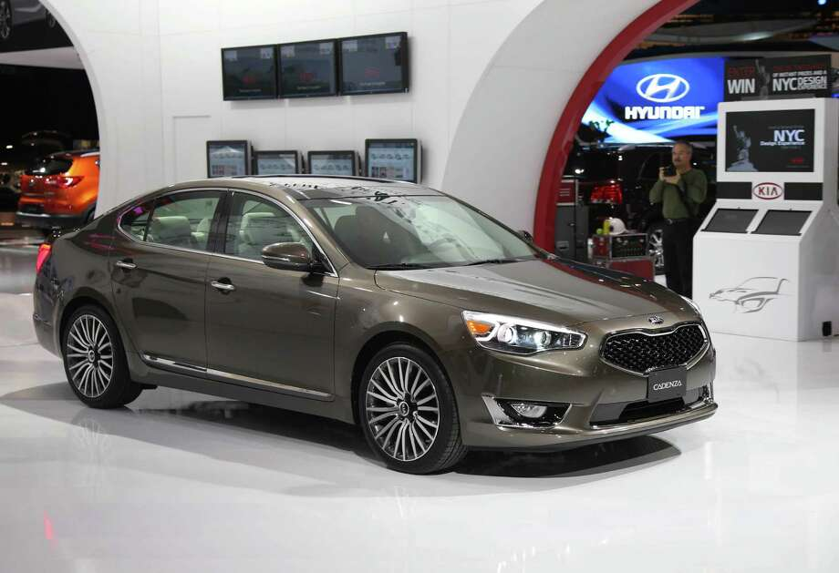 Kia pulled its full-size Amanti sedan off the market three years ago. Now, it returns and gets significantly more upscale with the 2014 Cadenza. The Cadenza's big, 18-inch wheels and long, contoured hood give it a premium look. The Cadenza starts at $35,100, which includes complimentary maintenance for 36 months or 37,000 miles. Photo: Rene Johnston, Rene Johnston/Getty Images / 2013 Toronto Star
