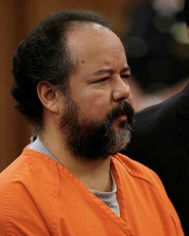 FILE - This Wednesday, July 17, 2013 file photo shows Ariel Castro standing before a judge during his arraignment on an expanded 977-count indictment in Cleveland. Castro, who held 3 women captive for a decade, has committed suicide, Tuesday, Sept. 3, 2013. Photo: Tony Dejak