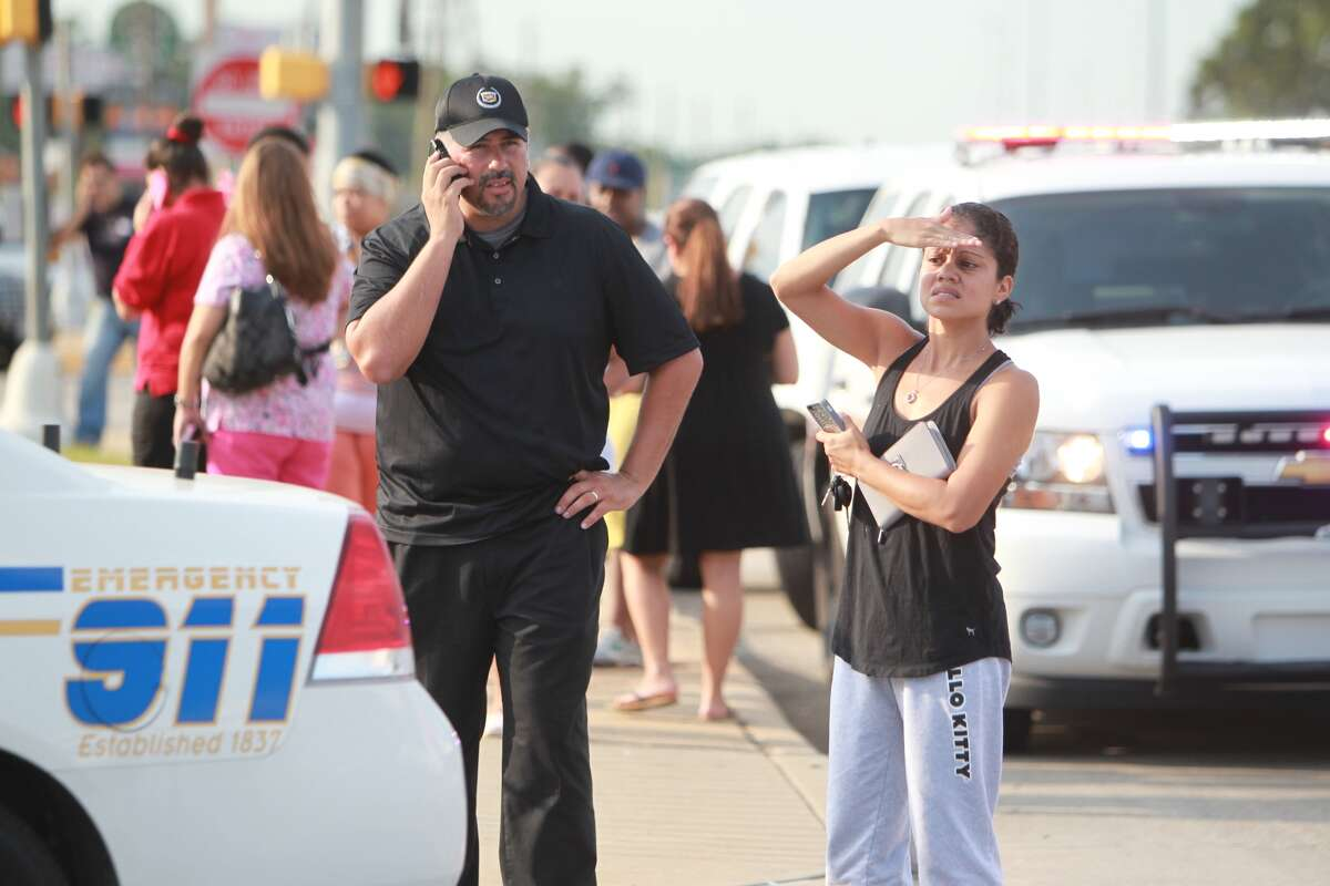 Concerned parents wait outside while police investigate a stabbing at Spring High School on Sept. 4.