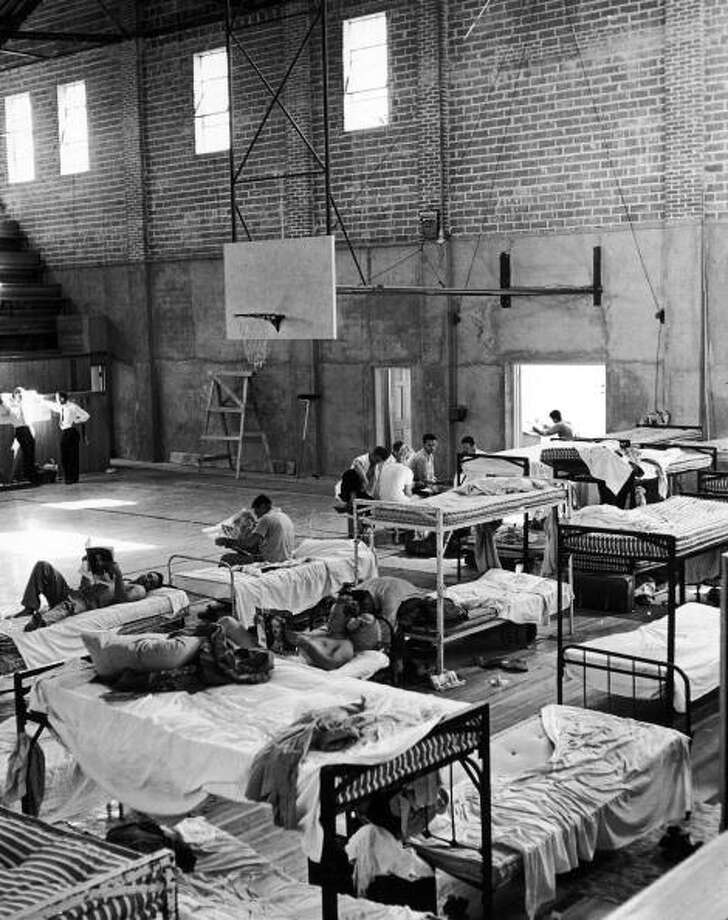 Saint Mary's University football team living in an unfinished qymnasium.  (Photo by Alfred Eisenstaedt/Time & Life Pictures/Getty Images) Photo: Alfred Eisenstaedt, Time & Life Pictures/Getty Image / Time & Life Pictures/Getty Images