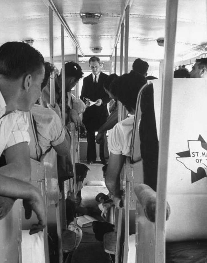 Members of Saint Mary's University football team listening to class lecture aboard bus en route to game in this 1939 photo from Life magazine.  (Photo by Alfred Eisenstaedt/Time & Life Pictures/Getty Images) Photo: Alfred Eisenstaedt, Time & Life Pictures/Getty Image / Time & Life Pictures/Getty Images