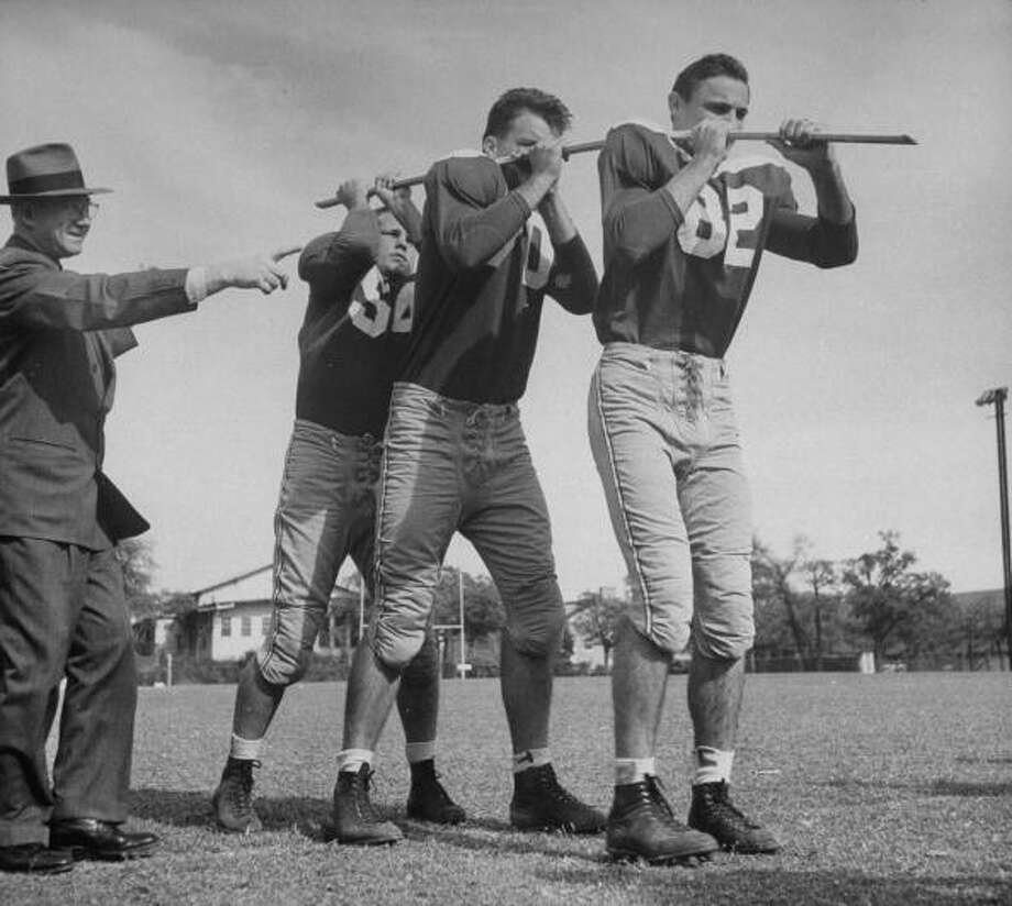 Circa 1940s - Dr. Franz Polgar (L) at the University of Texas, using group hypnosis on these male football players and convincing them that they are carrying a heavy load.  (Photo by Michael Rougier//Time Life Pictures/Getty Images) Photo: Michael Rougier, Time & Life Pictures/Getty Image / Time Life Pictures