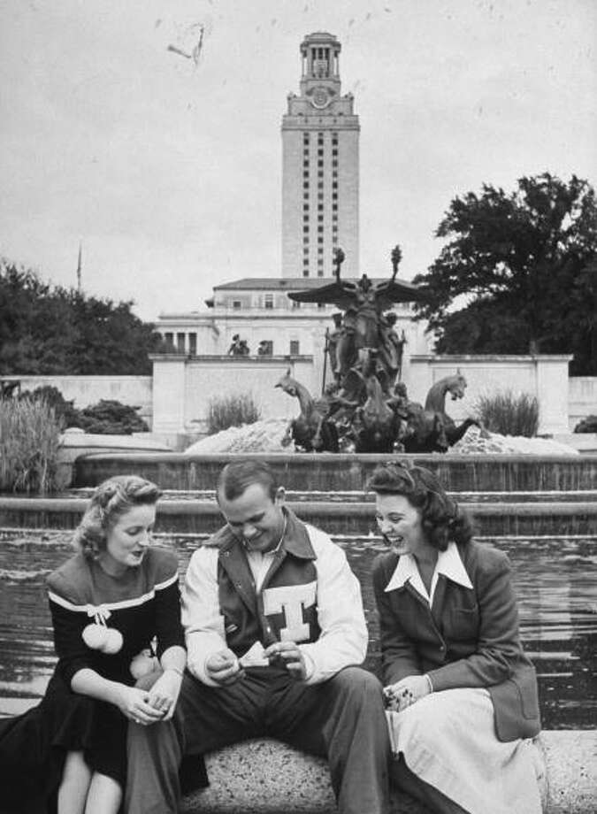 Circa 1940s - Univ. of Texas football player Jack Crain sitting with two female students.  (Photo by George Strock//Time Life Pictures/Getty Images) Photo: George Strock, Time & Life Pictures/Getty Image / Time Life Pictures