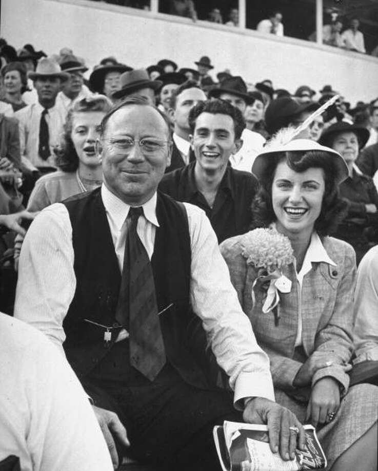 Couple attending a Texas college football game, circa 1940s.  (Photo by George Strock//Time Life Pictures/Getty Images) Photo: George Strock, Time & Life Pictures/Getty Image / Time Life Pictures