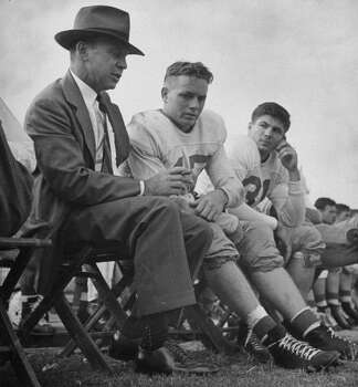 Circa 1940s - Football coach Dana Bible (L) of the Univ. of Texas talking to players on the sidelines.  (Photo by George Strock//Time Life Pictures/Getty Images) Photo: George Strock, Time & Life Pictures/Getty Image / Time Life Pictures